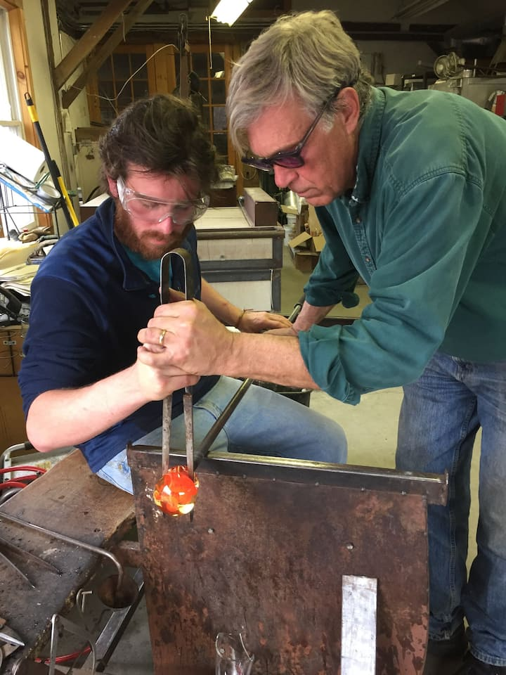 Robert helping to form glass