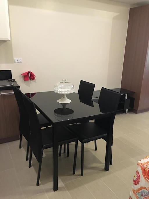 Dining table  (Kitchenware provided: Pans, Rice cooker, Oven, Utensils, Plates, Kettle etc.)