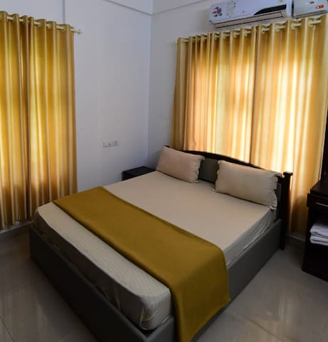 Air-conditioned bedroom with attached bathroom