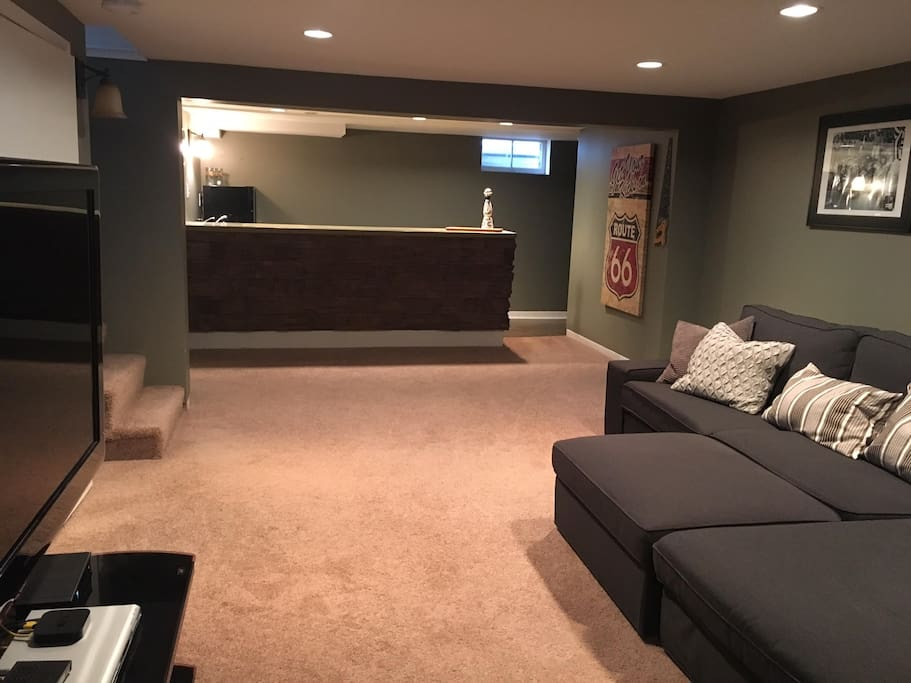 Lower level living room area with wet bar