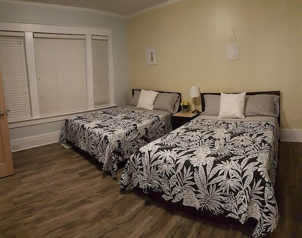"PINEAPPLE ROOM: Two double firm orthopedic beds, fits up to 4 people comfortably in spacious room. Private en-suite bathroom. 43"" Smart 4K TV with Netflix ready to go! Room is a private locked room."