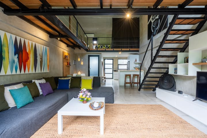 Spacy living room with comfy colorful sofa
