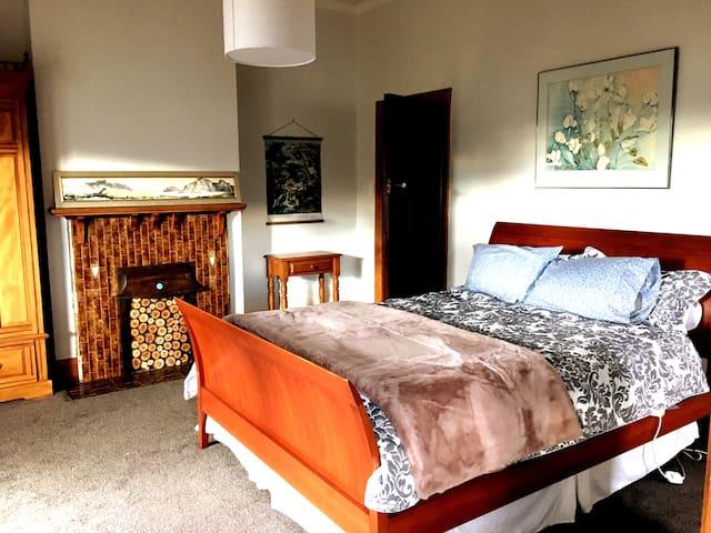 Master Bedroom - Queen Bed, doors open on to a verandah, with ensuite.