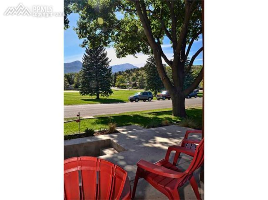 Sitting on the front porch  looking out at Pike's Peak and the park.