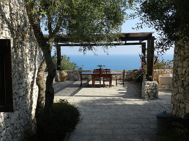 Main entrance - Upper level - Pergola with sea view