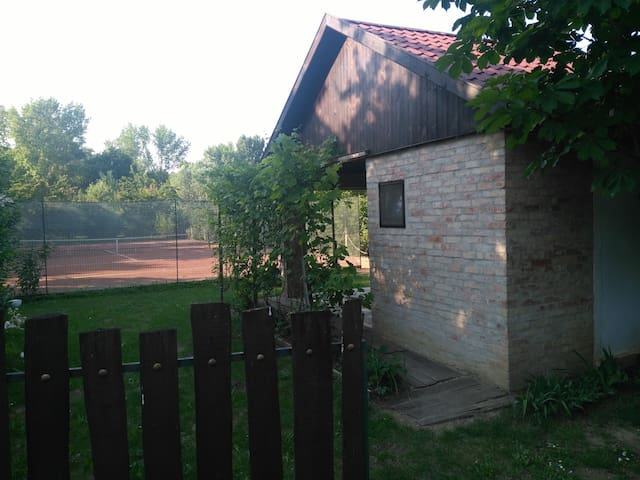 Small house with tennis court
