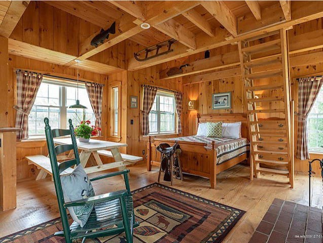Inside the Cabin. Queen bed sleeps two, ladder to the loft for two more twin beds.