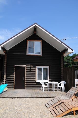 двухэтажный дом в оцилиндрованном бревне - Sukko - House