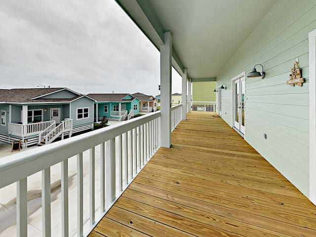 An enormous balcony offers a great spot to step outside and enjoy the fresh coastal breeze.