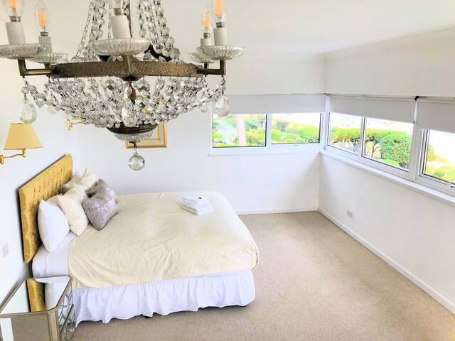 Bedroom 1 with sea view, balcony and en-suite shower room