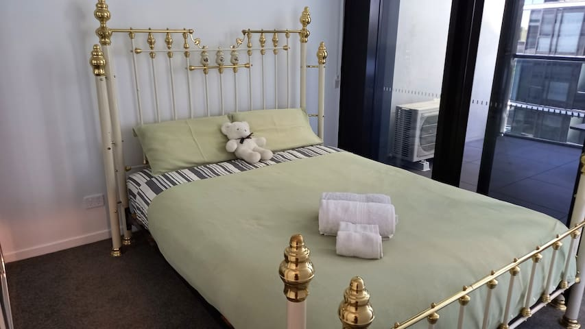 Bedroom with balcony, queen size  bed
