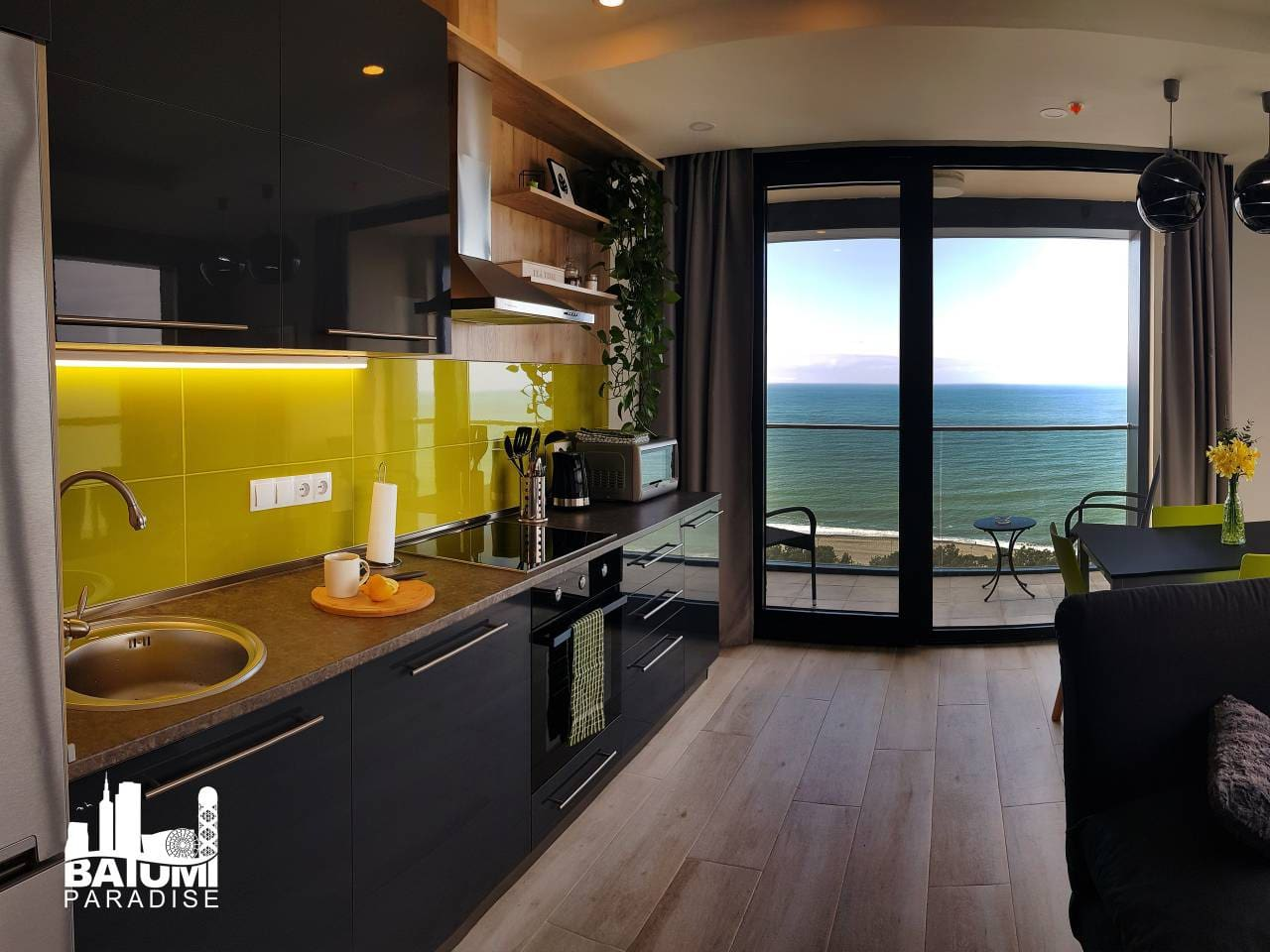 Beachfront Apartment with Panoramic View kitchen and the view of the Black Sea.