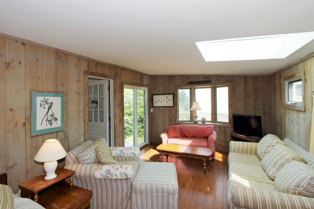 The family room has a TV and direct access to the deck.