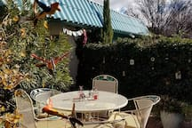 The patio area in December with wooden birds from Thailand