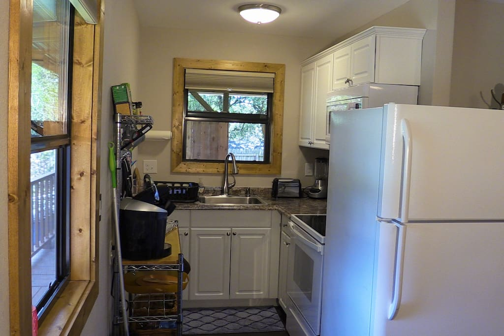 Kitchen with full size stove and refrigerator