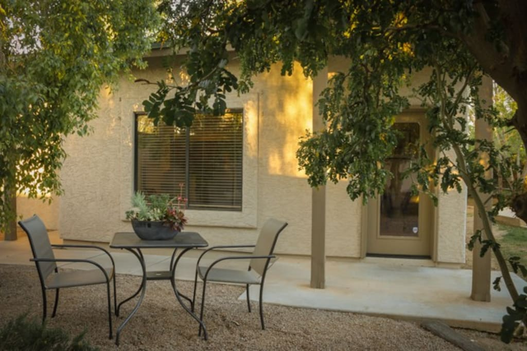 Entry way to casita with outdoor dining area.