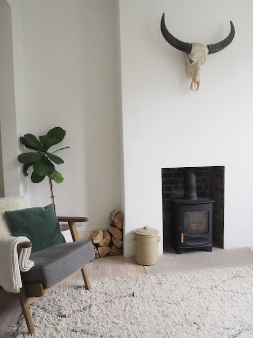 Bright, cosy lounge with log burner