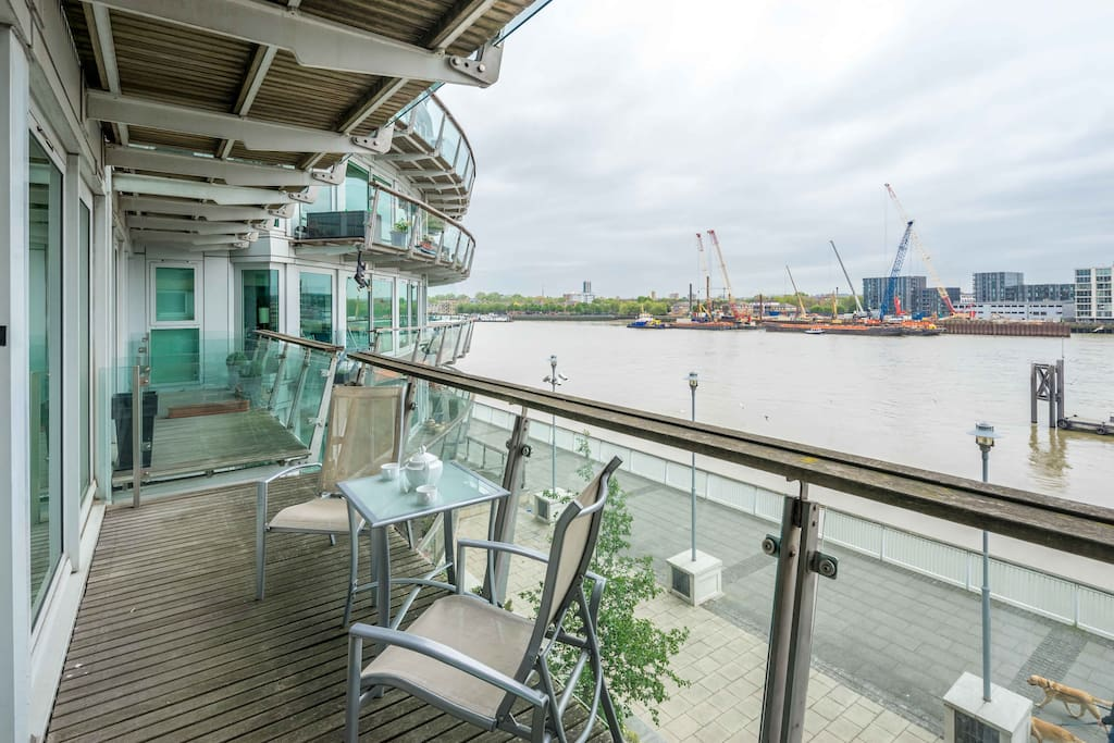The amazing balcony which can be accessed from the living room and the bedroom with spectacular views over the River Thames and table and chairs.