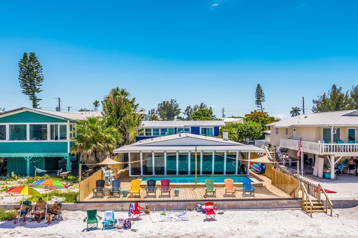 Beachfront with stunning views, heated pool, golf cart, bikes and water toys