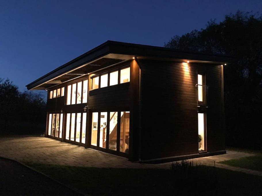 Cedar House at night