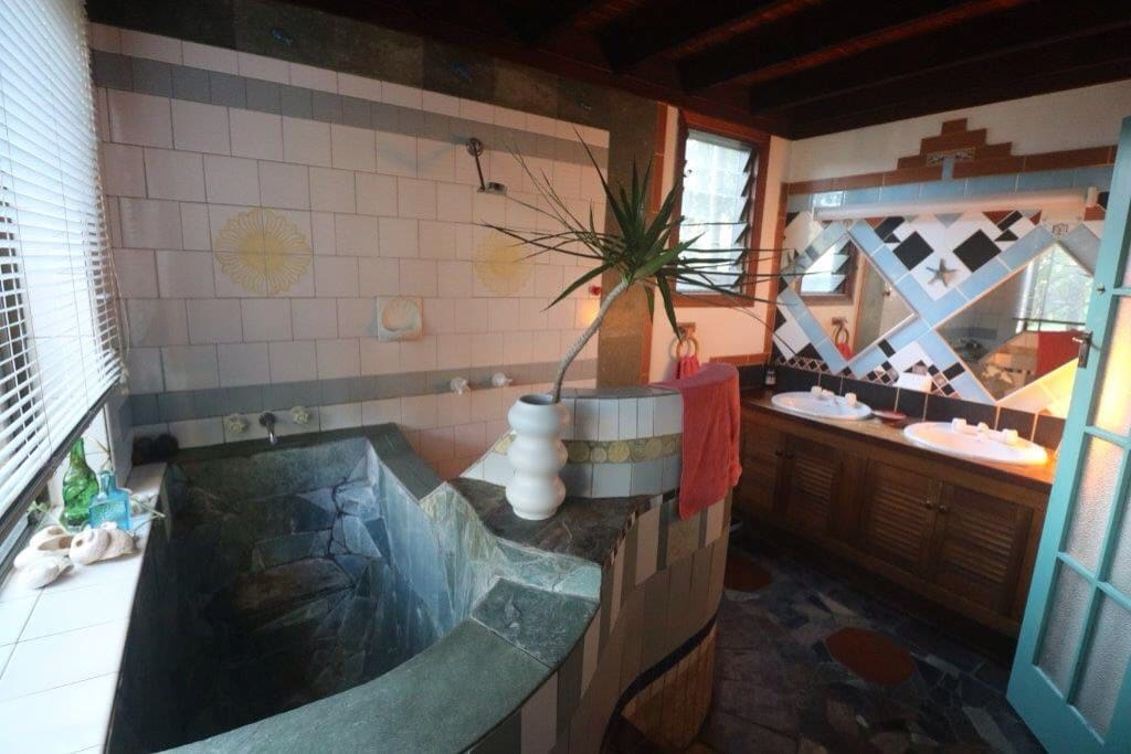Huge and unique bathroom complete with Japanese-style bath tub, very deep!