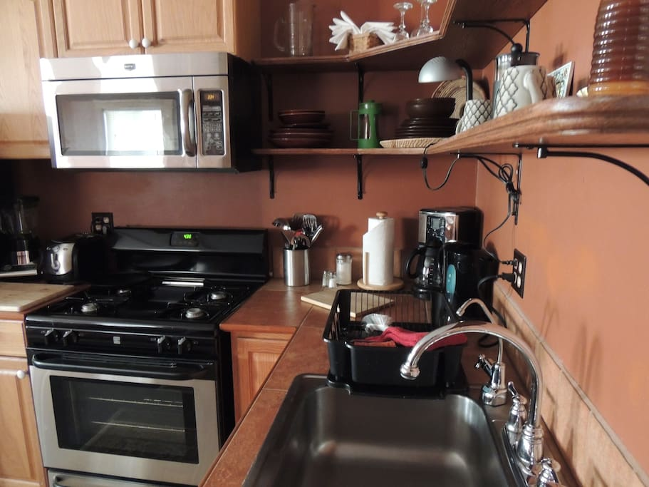 Fully equipped kitchen with serving and cookware.