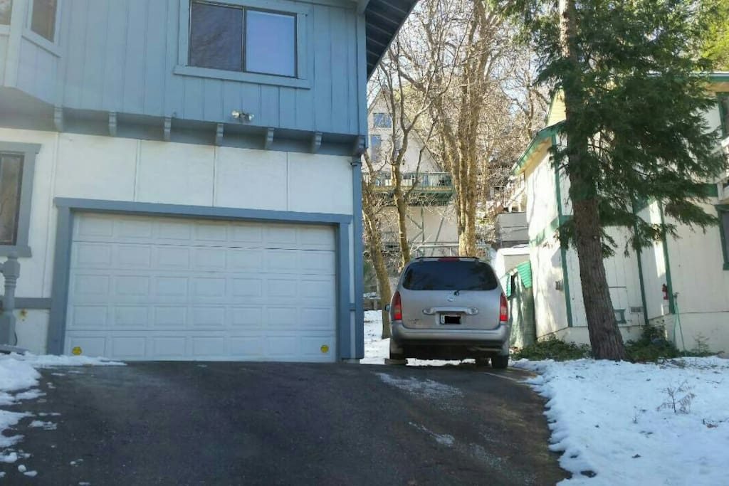 Garage and extra parking spaces on the side of the house