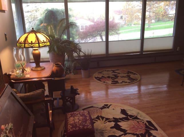 Living room area with plenty of daylight windows.