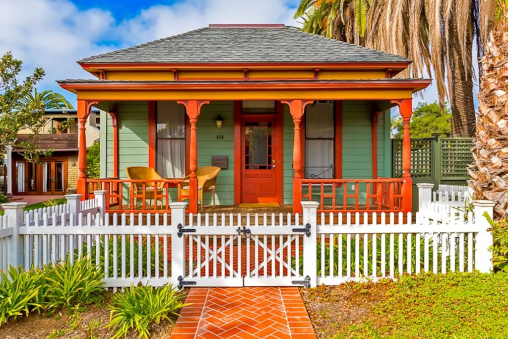 Historic 1 bedroom home welcomes you with white   picket fence and inviting front porch.
