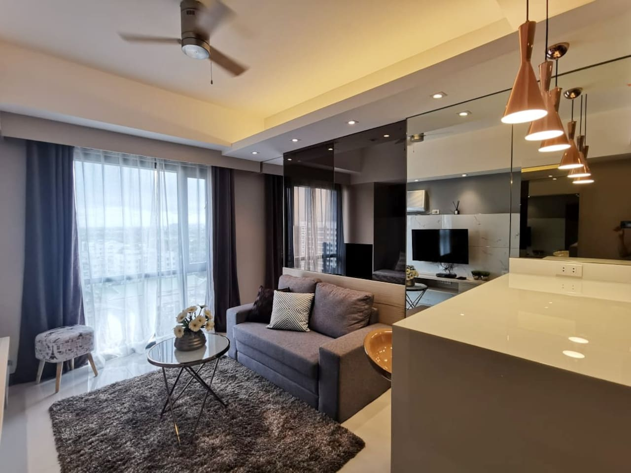 Living area is equipped with luxe furnishings, as well as a sofa bed which can fit up to 2 persons.