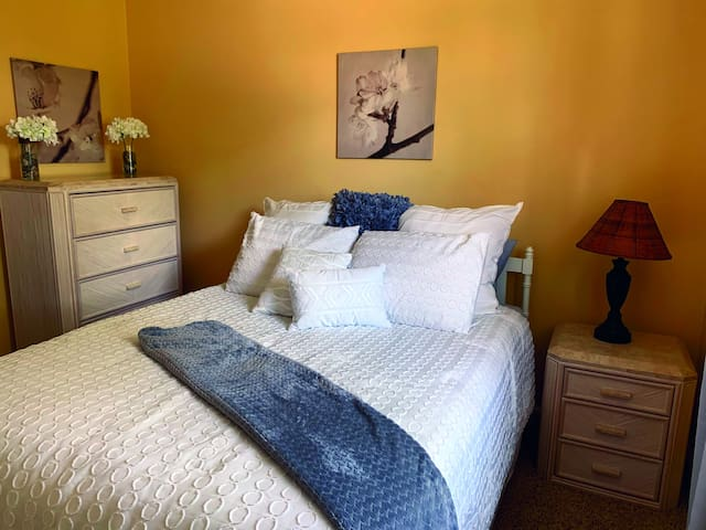 Enjoy the comfy queen size bed in the master bedroom.  Plenty of dresser space is available for you to unpack and put away your clothes.