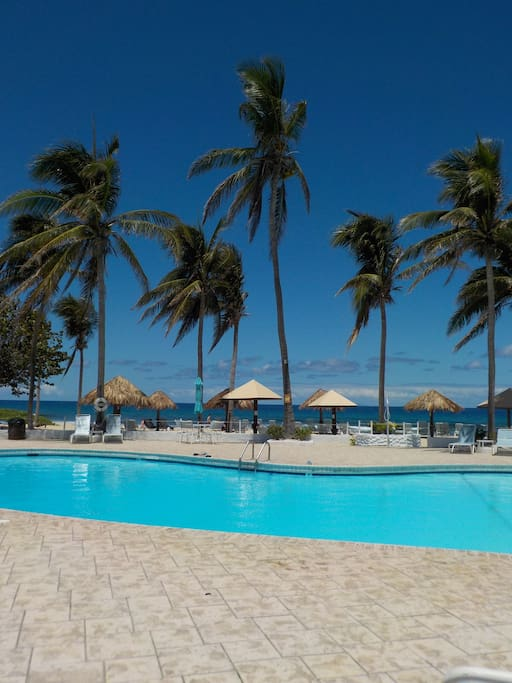Large beachfront swimming pool with spacious sundeck