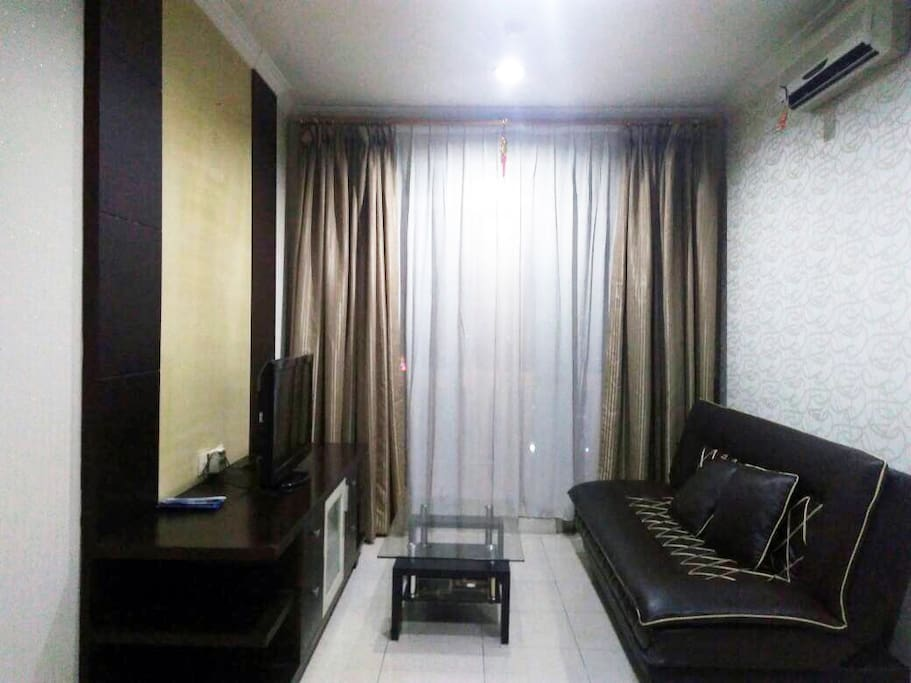 Living room with sofa bed & TV