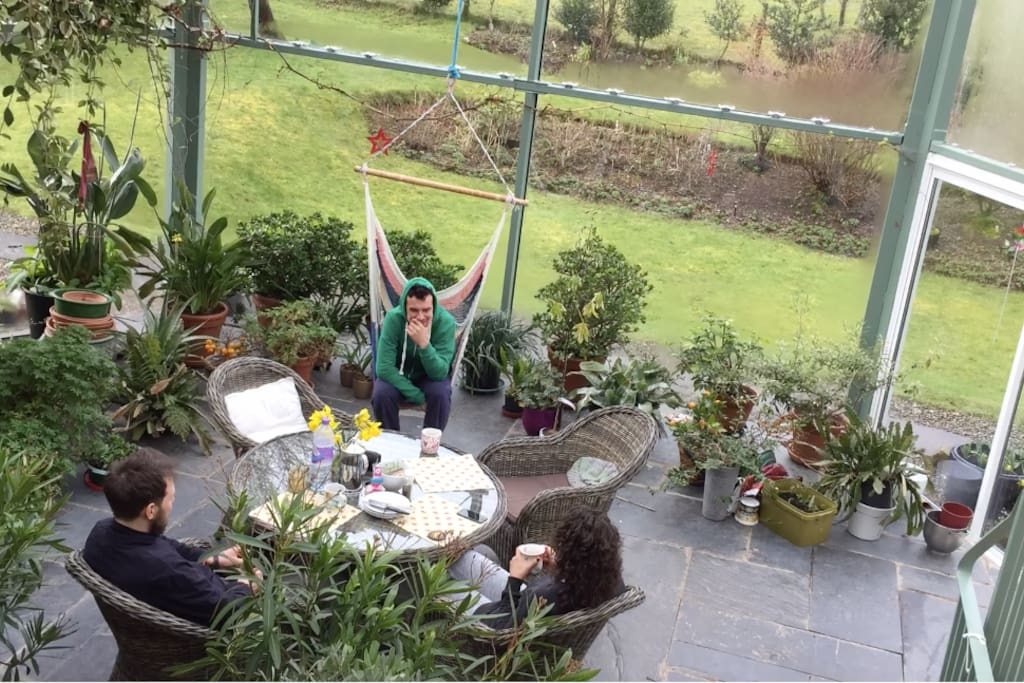Recent guests enjoying the atrium (and the squash court and sauna when it rained one day)