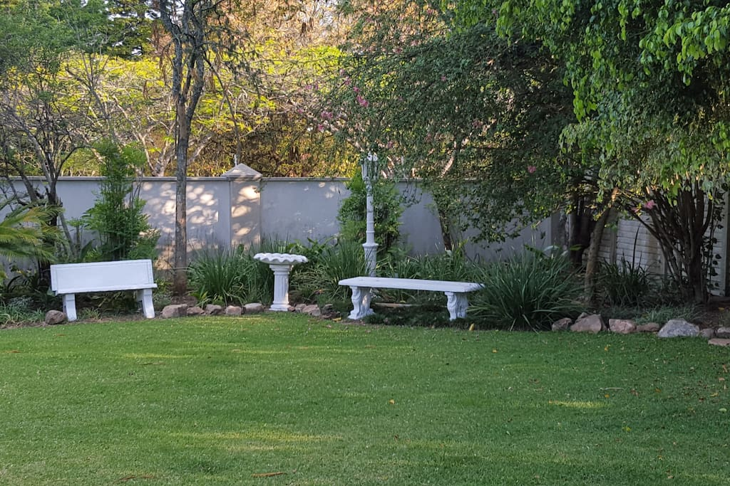 A beautiful part of the garden where Guests can relax and enjoy the birdlife