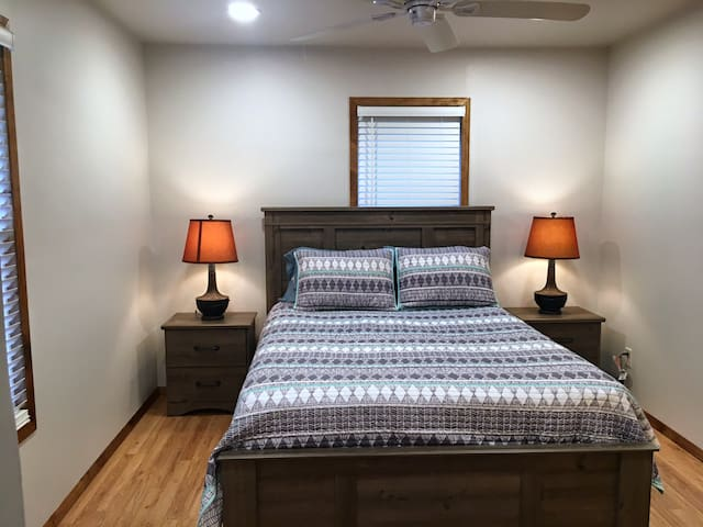 One Queen Bed with firm mattress. Ceiling Fan.