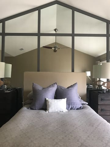 2nd floor master master, relax in bed and watch tv. Roll out of bed and enjoy a cup of coffee on the private deck.