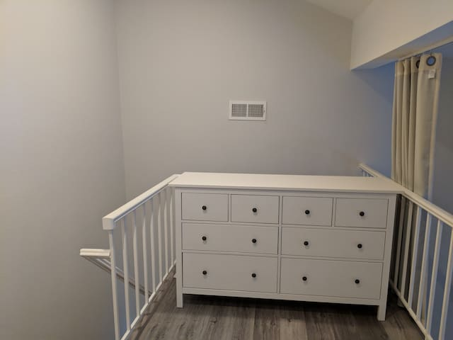 Loft with dresser and private staircase