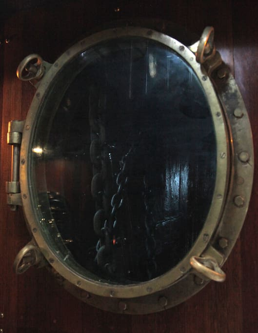 Historic porthole views through to chain locker