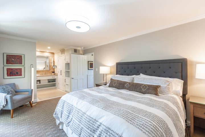 Spacious bedroom with king sized bed and ensuite bathroom.