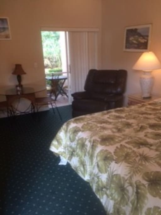 Cozy bed, dining table, BIG chair, private lanai