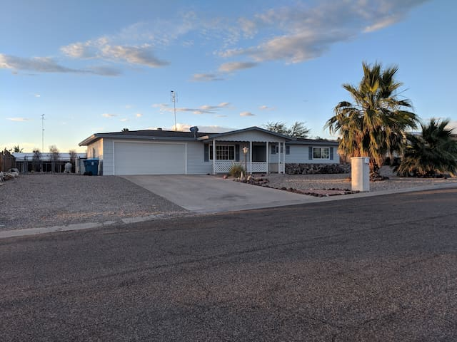 Quiet street & friendly neighborhood w/relaxing views. RARE-TO-FIND centrally located home. Plenty of parking for you and your boat. Park your boat on the gravel rocks or pull it into the back.  4wheel drive strongly advised for traction.