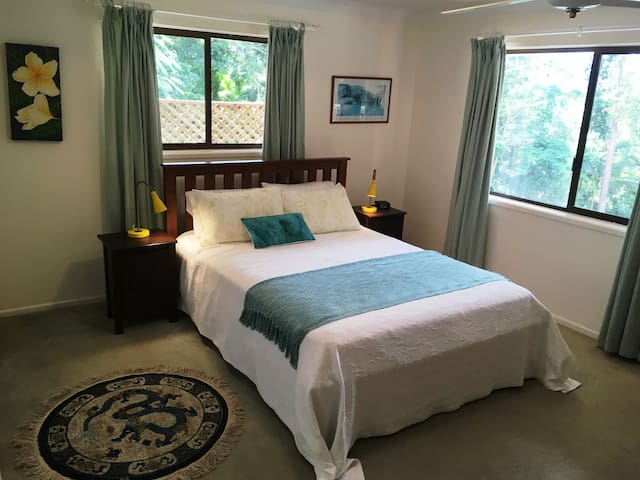 Spacious bedroom with views to Tweed River and rainforest.