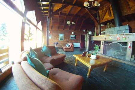 Habitación cuádruple con vista al jardín - San Carlos de Bariloche