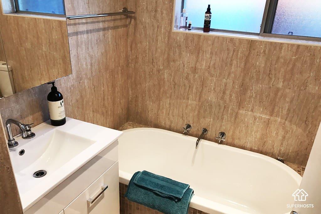 Renovated bathroom with bath tub