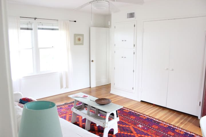 Bright and cheerful sitting area connected to your bedroom (door to the right) and bathroom (door to the left not shown here).  Closet is filled with games and a futon bed (to use upon request)