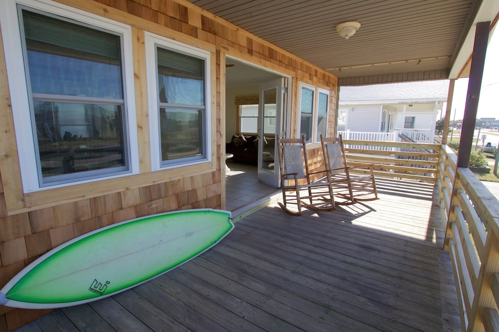 French Doors are open so come on in, join us.  The front porch is great spot to sip a coffee to start your morning + relax at the end of a day at the beach