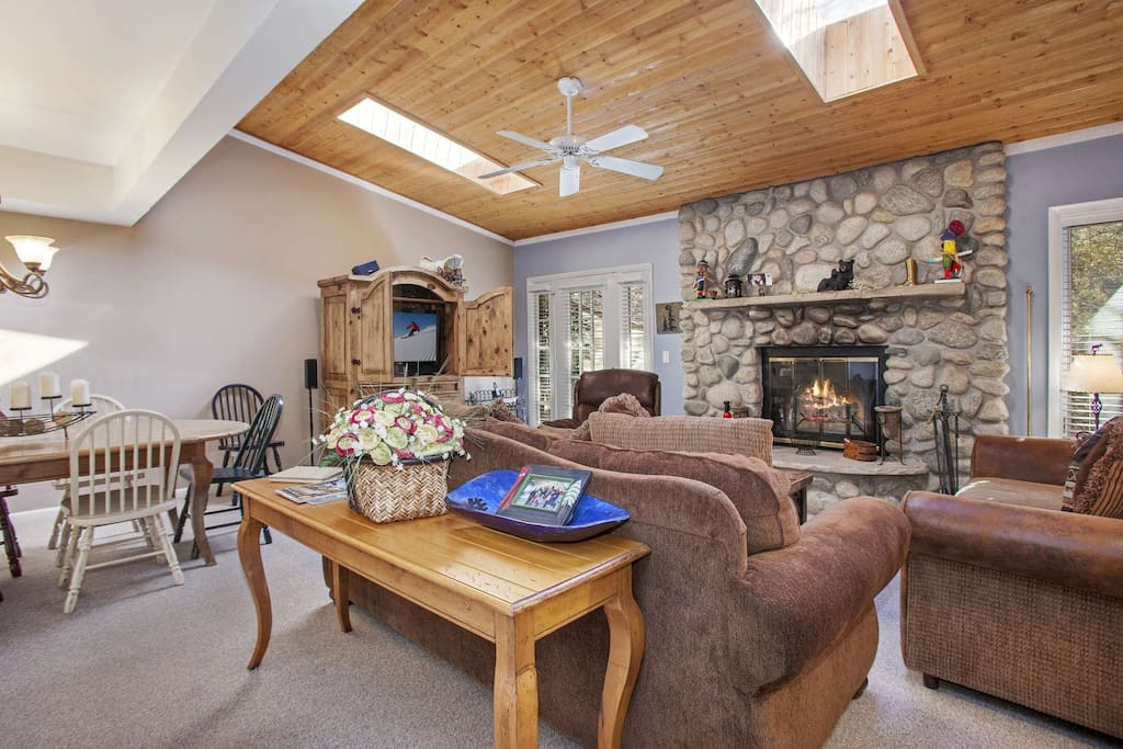 Cozy up to the beautiful wood burning stone fireplace.