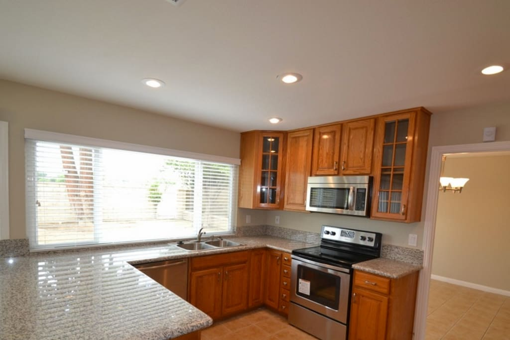 large spacious kitchen space, outlooking to the backyard!