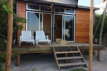 The front of the Micro Casa. A nice deck to watch the goings on out there. Pelicans, frigates, terns and osprey hunt right off the beach pretty much daily. Very entertaining.